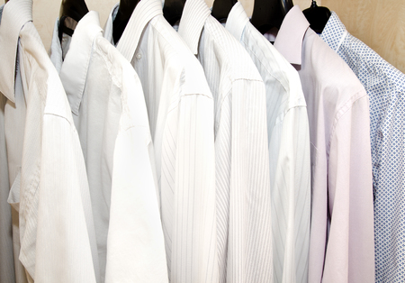 shirts on hangers: Mens shirts on hangers in the wardrobe