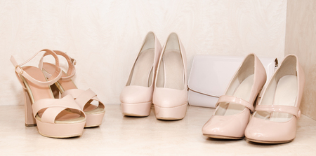 clutch: Womens shoes and clutch in the wardrobe Stock Photo