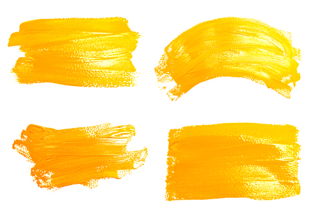 yellow ochre: Collection of photos yellow strokes of the paint brush isolated on a white