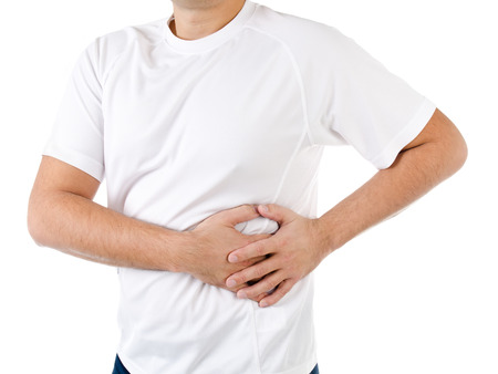 soreness: Man suffering from pain in the left side isolated on a white