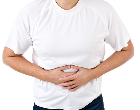 constipation symptom: Man suffering from stomach pain isolated on a white Stock Photo