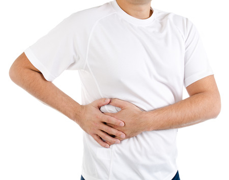 Man suffering from pain in the right side isolated on a white Stock Photo
