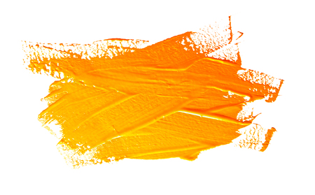 Yellow ochre strokes of the paint brush isolated on a white