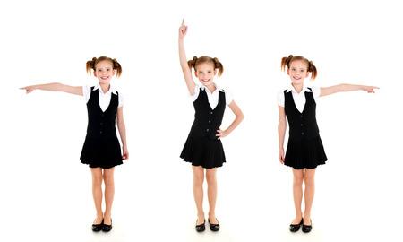 Collection de photos souriante fille de l'école heureuse en uniforme montrant à droite à gauche et vers le haut isolé sur un fond blanc Banque d'images - 82627149