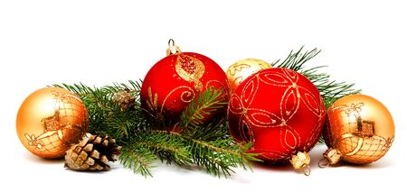 Christmas decoration red golden yellow balls with fir cones and fir tree branches isolated on white background Stock Photo