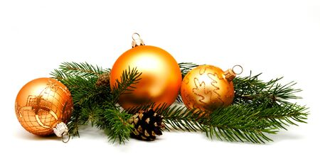 Christmas decoration golden yellow balls with fir cones and fir tree branches isolated on white background Stock Photo