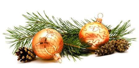 Christmas decoration golden yellow balls with fir cones and fir tree branches isolated on a white background Stock Photo