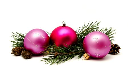Christmas decoration lilac magenta balls with fir cones and fir tree branches isolated on a white background Stock Photo
