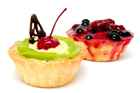 Delicious cakes pastry with fruit raspberry currant kiwi isolated on a white background