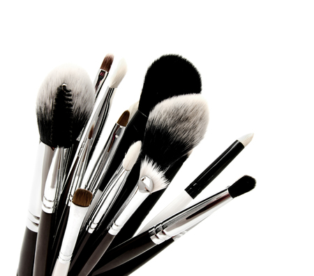Various set of professional makeup brushes isolated over white