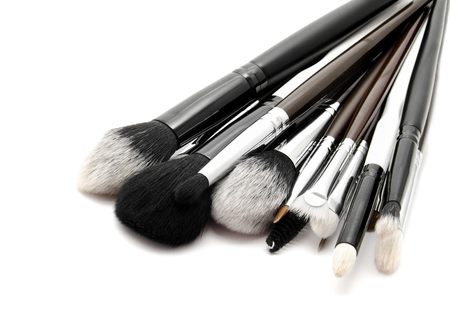 Various set of professional makeup brushes isolated over white background Stock Photo