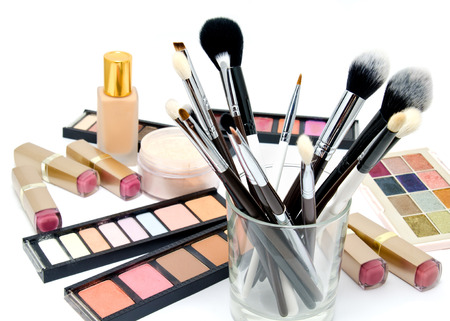 Various set of professional makeup brushes and cosmetics and palette of colourful eye shadows isolated over white background 版權商用圖片