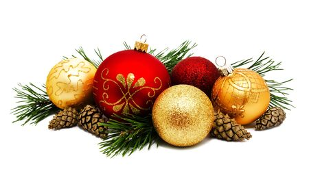 Christmas decoration golden yellow and red balls with fir cones and fir tree branches isolated on a white 写真素材