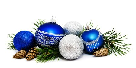 Christmas decoration blue and silver balls with fir cones and fir tree branches isolated on a white