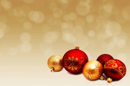 Christmas perfect decoration red and gold yellow balls isolated on golden blurred bokeh 写真素材
