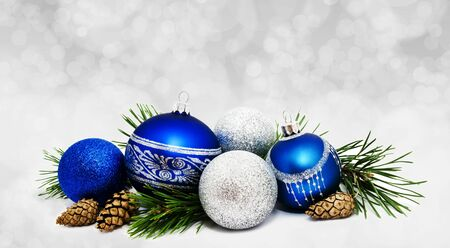 Christmas perfect decoration blue and silver balls isolated on golden blurred bokeh