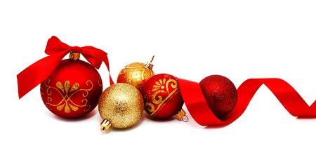 Christmas decoration red and gold yellow balls with ribbon isolated on a white 写真素材