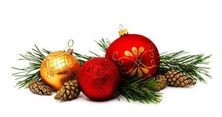 Christmas decoration golden yellow and red balls with fir cones and fir tree branches isolated on a white Stock Photo