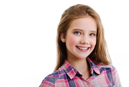 Portrait of adorable smiling little girl child preteen isolated on a white background Stock Photo