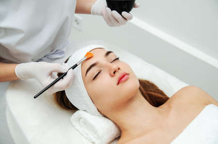 Woman getting face beauty treatment procedure in medical spa center. Skin rejuvenation concept Stock Photo