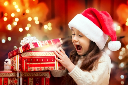 Child in Santa hat with gift box  photo