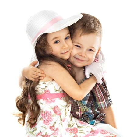 Portrait of funny little boy and a cute girl hugging