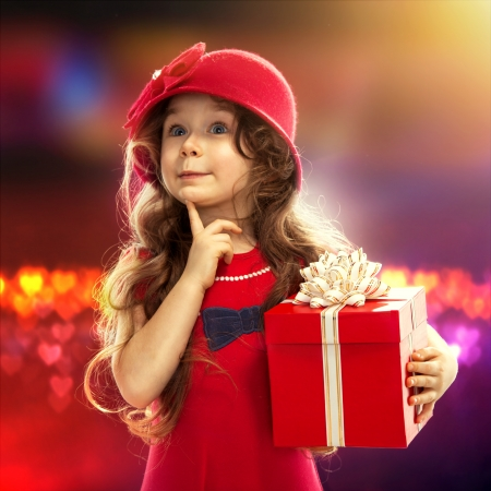 Holidays, presents, happiness concept  Happy child girl with gift box