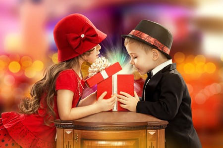 Happy children opening magic gift  Present for a birthday, valentine s day or other holiday