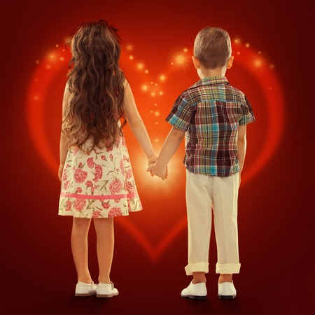 Back view of little girl and boy holding hands  Love, friendship, Valentine s Day concept Stock Photo - 25868534