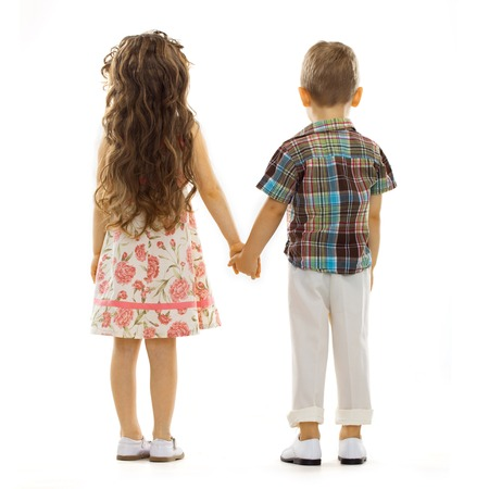 Back view of little girl and boy holding hands  Love, friendship concept  Isolated on white background