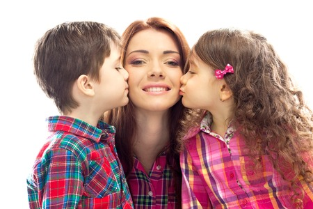 Portrait of children kissing her mother with flowers  Mothers day concept  Family holiday  Isolated white background Standard-Bild