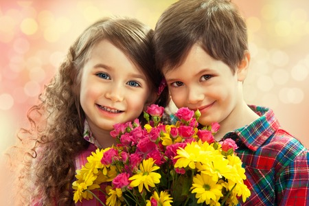 human's arm: Happy boy and girl with bouquet of flowers  Spring, Mothers day, family holiday