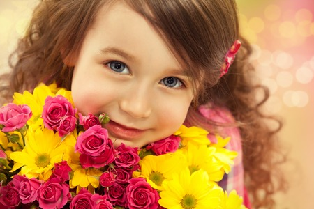 womens day: Smiling girl with a bouquet of flowers   Spring, March 8, International Womens, Mothers day, family holiday Stock Photo