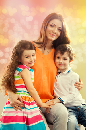 Portrait of children with her mother  Spring, March 8, International Womens, Mothers day, holiday, happy family Stock Photo - 26577812