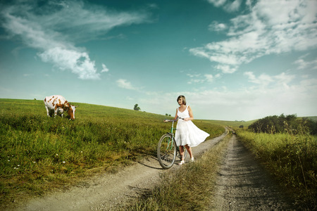 Happy woman on a bike in the countryside  Outdoor shot