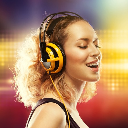Portrait of young beautiful woman with headphones listening music  Happiness concept  photo