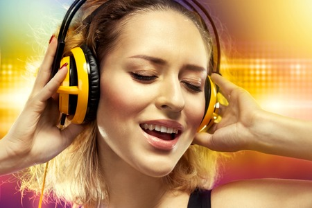 Young woman feeling happy listening music with headphones  Happiness concept
