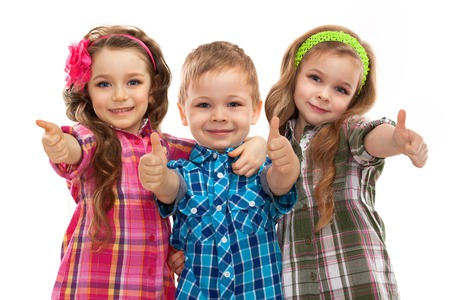 Cute fashion kids showing thumbs up, on the white .Fashionable and friendship concept Standard-Bild