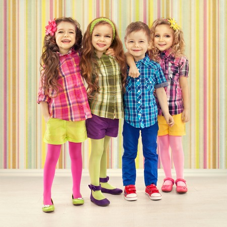 Cute fashion kids are standing together  Fashionable and friendship concept