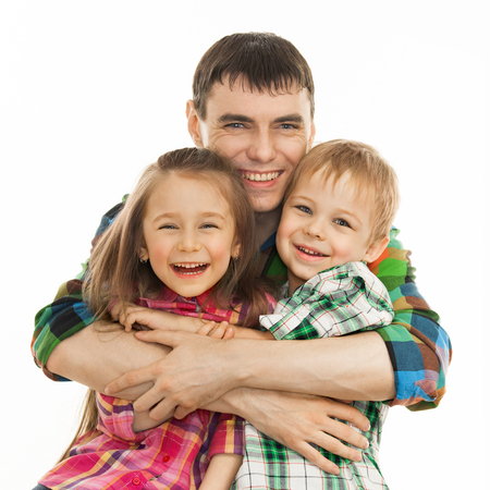 Portrait of joyful father hugging his son and daughter  Isolated on white background  Fathers day, family holiday, vacation photo