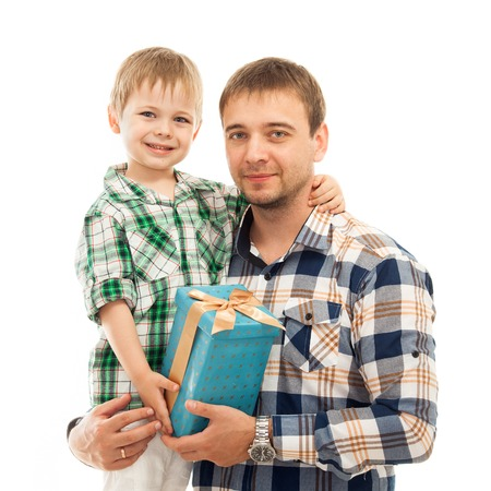 Happy son hugging his father and gives him gift Fathers day, family holiday, vacation Isolated white background