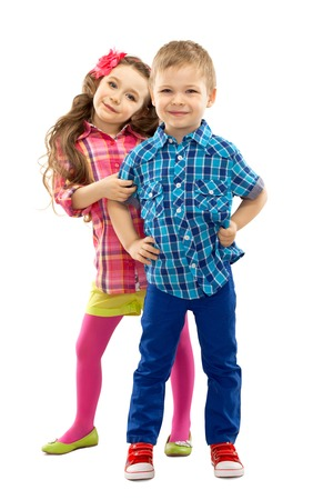 Cute fashion kids are standing together, on the white background   Fashionable and friendship concept