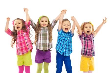 happy young: Felices los ni�os lindos est�n saltando juntos aislada Felicidad fondo blanco, de moda y el concepto de la amistad Foto de archivo