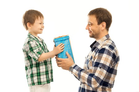 Happy son gives his father gift  Isolated white background  Fathers day, family holiday, vacation