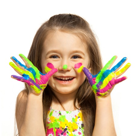 Funny little girl with hands painted in colorful paint  Isolated on white background  Standard-Bild