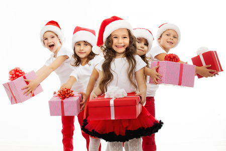 Group of happy kids in Christmas hat with presents. Isolated on white background. Holidays, christmas, new year, x-mas concept.