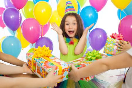 happy birthday girl: Joyful little kid girl receiving gifts at birthday party. Holidays, birthday concept.