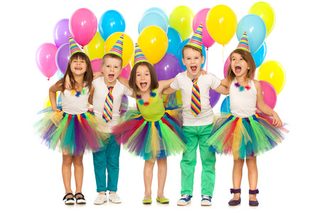 row: Group of joyful little kids having fun at birthday party. Isolated on white background. Holidays, birthday concept. Stock Photo