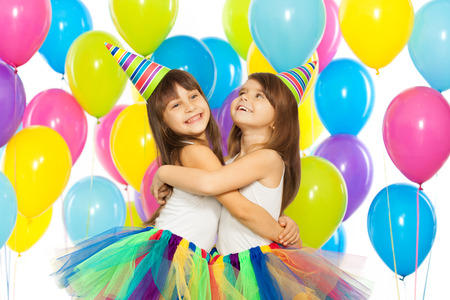 Two little girls at birthday party. Holidays concept.