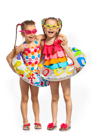 swimming to float: Happy kids in swimsuit and inflatable rings. Isolated on white background. Summer, fashionable, friendship concept.